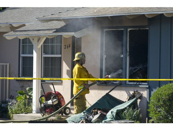 Firemen try to save Orange County home